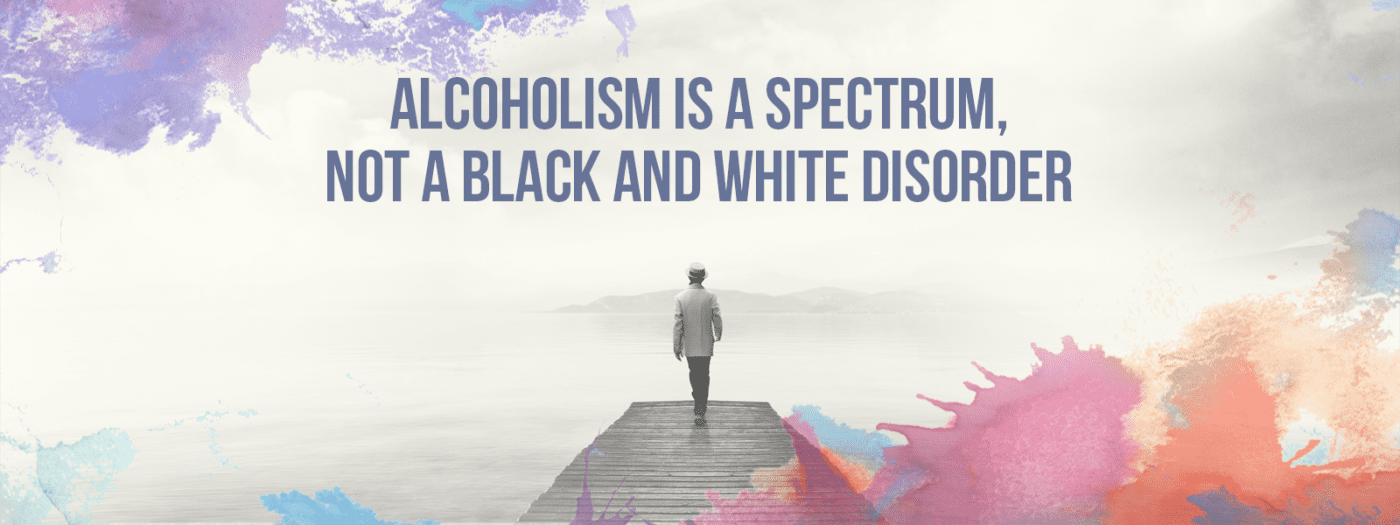 Alcoholism | Alcohol Treatment | guy walking down dock colorful | Alcoholism is a spectrum not a black and white disorder